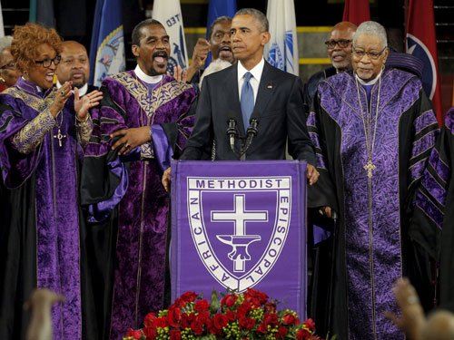 Obama sings hymn of hope in eulogy for slain church members