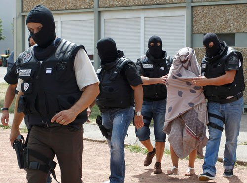French police interrogate suspect after grisly decapitation