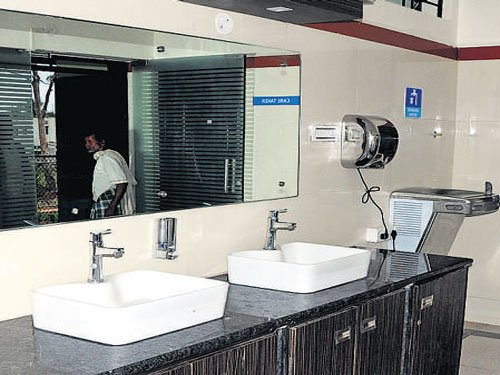 Washing machine, hair dryer in this public bathroom