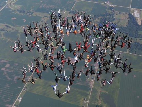 164 skydivers smash head-down world record in Illinois