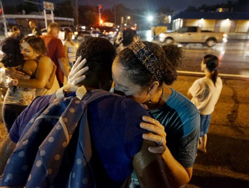 Gunshots heard as Ferguson protests turn violent a year after Brown shooting