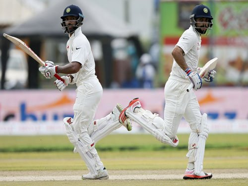 Tons by Kohli, Dhawan put India in driver's seat