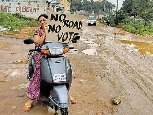 Art teacher creates buzz with 'No Road No Vote' campaign