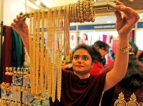 Gold at over 6-week high on global cues; up Rs 365