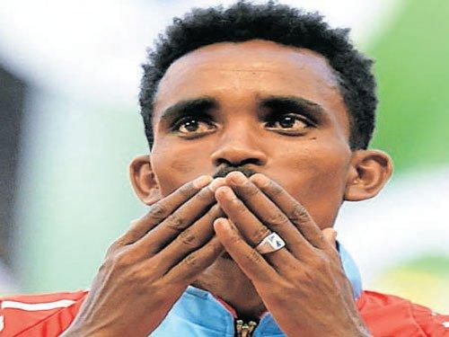 Teen Ghebreslassie wins historic marathon gold