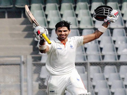 Ojha, Nair to replace injured Saha, Vijay in Test squad