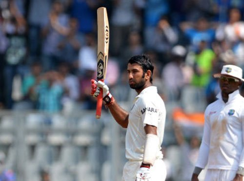 Ton-up Pujara, Mishra quash Lankan charge