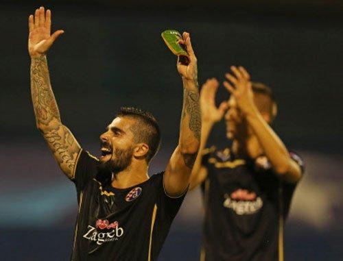 Zagreb stun Arsenal as Roma hold Barca to draw