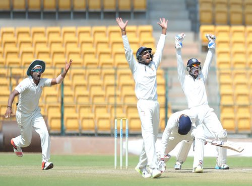 Aravind, Suchith share 8 wickets as K'taka take slender lead