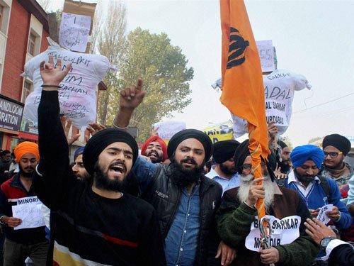 Congress activists burn Badal's effigy; one protester dies in Punjab