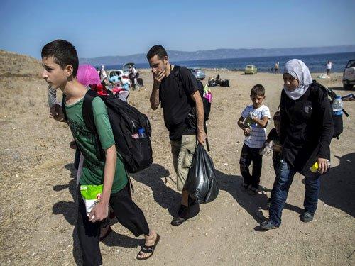 Germany toughens up asylum rules as migrants stream in