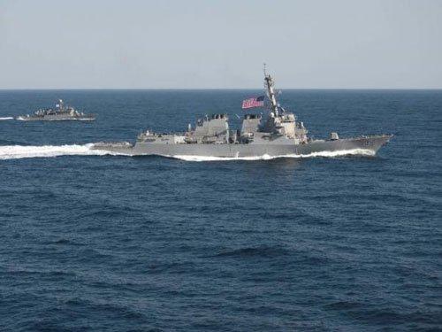 Angry China says shadowed US warship near man-made islands in disputed sea