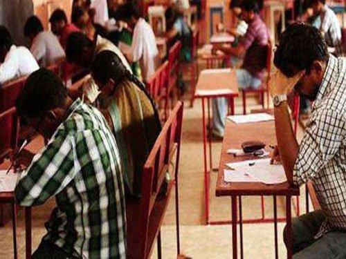 Aspirants go shirtless to write R'than civil service exam