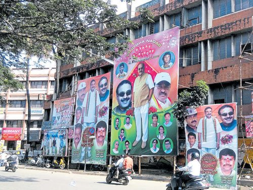 MLA's supporters deface JC Road with hoardings, posters