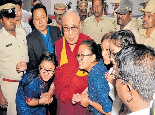 Education, not prayers will solve world's problems: Dalai Lama