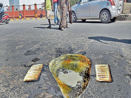 Toilet in the middle of road?  Art work bares potholes