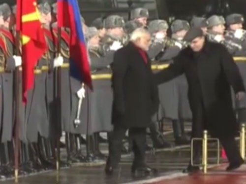 PM walks during national anthem, Russian official nudges him back