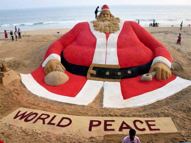 Sand artist creates  45 feet high Santa