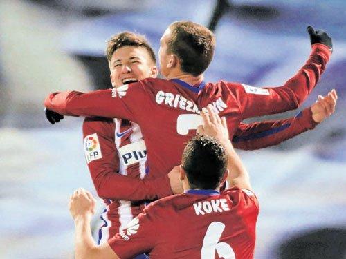 Atletico Madrid recapture top spot