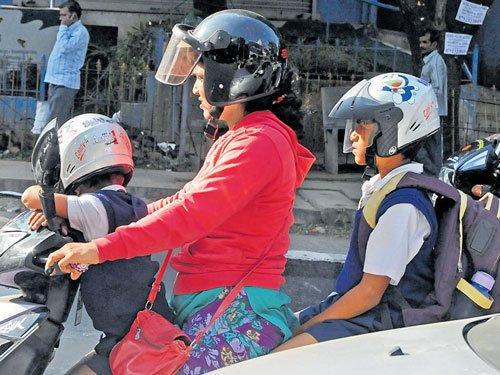 On Day 1, few pillion riders wear helmet; cops soft
