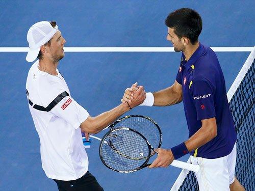 Djokovic glides through