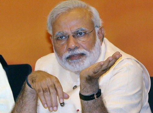 Modi congratulates Shah on re-election as BJP chief