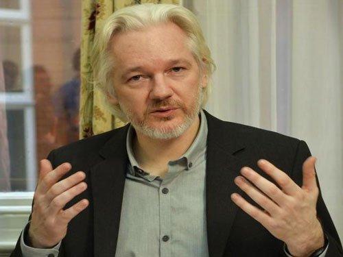 Assange says will accept arrest if UN panel rules against him