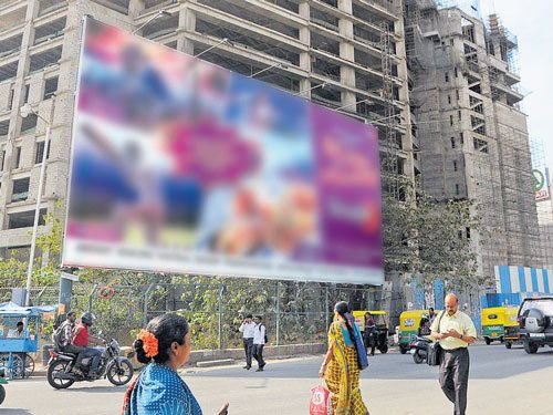 Hazy law, growing profits drive boom in illegal ad hoardings