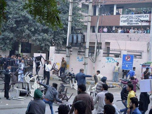 Police station, petrol pump set afire in Meham