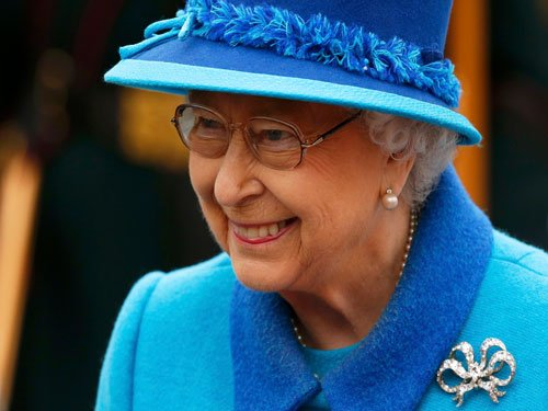 Queen's dogs served steak on silver platters