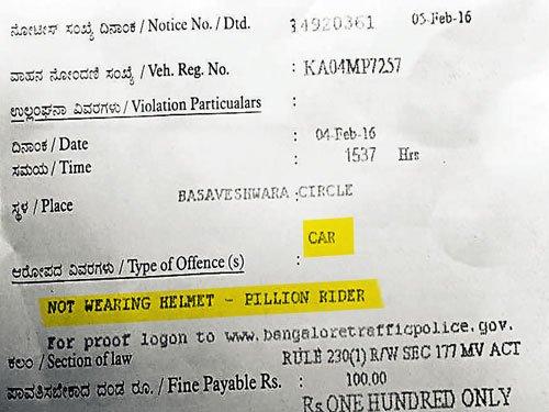 Owner of car fined for violating helmet rule