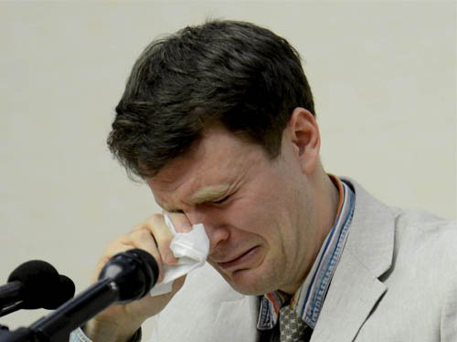 North Korea puts tearful detained American before cameras