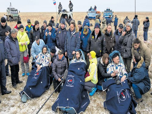 International Space Station's 'one year crew' returns home