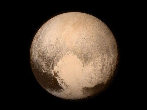 Methane snow discovered on Pluto's peaks: NASA
