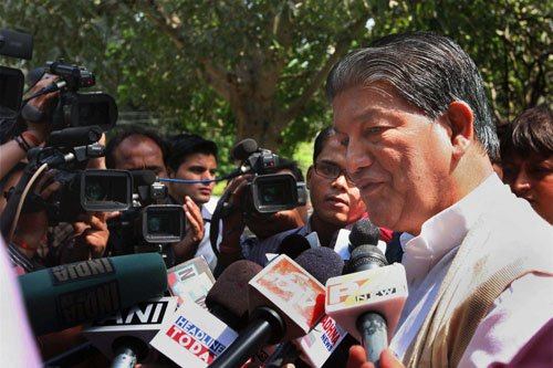 Governor asks CM Rawat to prove majority by March 28