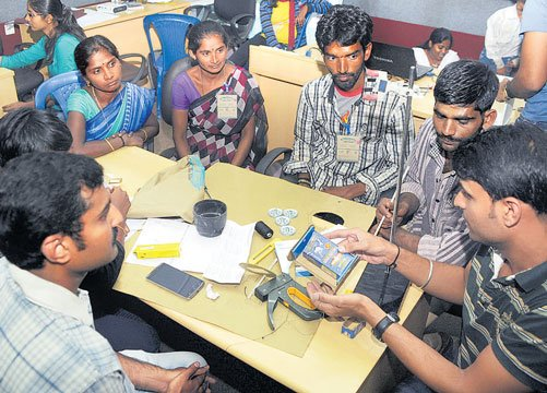 Thrashing out waste-pickers' trash woes at hackathon