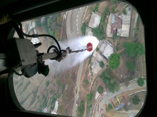 IAF chopper sprinkles water to douse U'khand forest fires