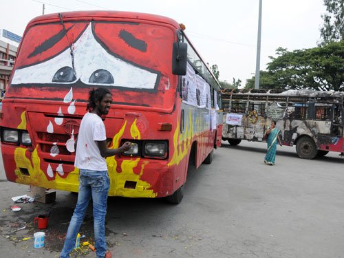 A 'funeral' of burnt buses to dissuade rampaging mobs