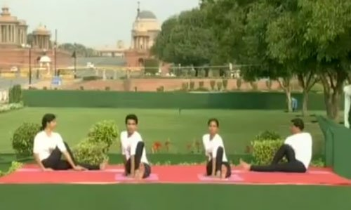 'Om', mantra chanting, in Yoga Day session