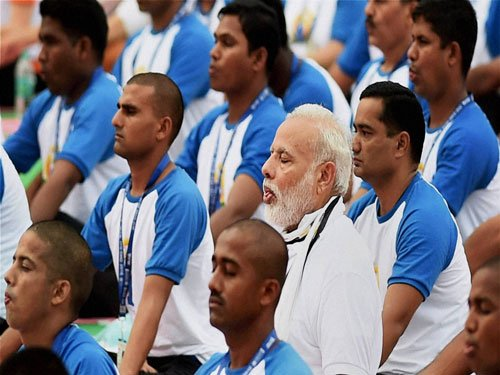 Yoga not a religious activity, says PM