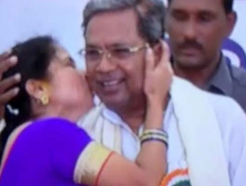 Woman kisses Karnataka Chief Minister in public