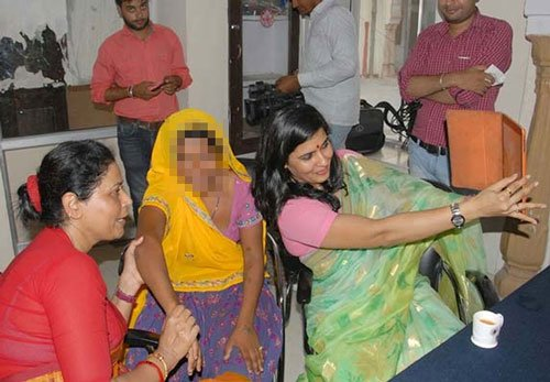 Raj women commission member clicks selfie with rape victim