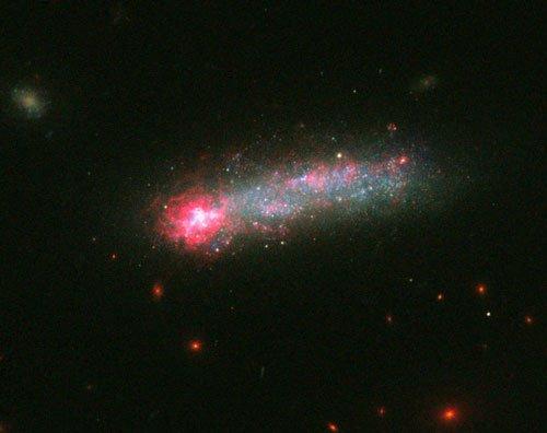 Hubble spots stellar fireworks in 'skyrocket' galaxy