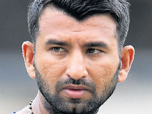 Pujara hits ton, Blue in command