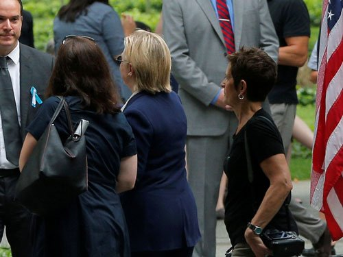 Clinton leaves 9/11 memorial abruptly, campaign says 'unwell'