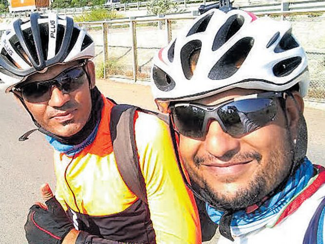 Two city cyclists ride 2,500 km to raise funds for disabled kids