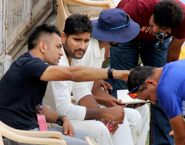 Mentor Dhoni cheers Jharkhand boys from the sidelines