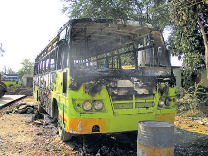 Guard found dead inside charred bus in NWKRTC depot