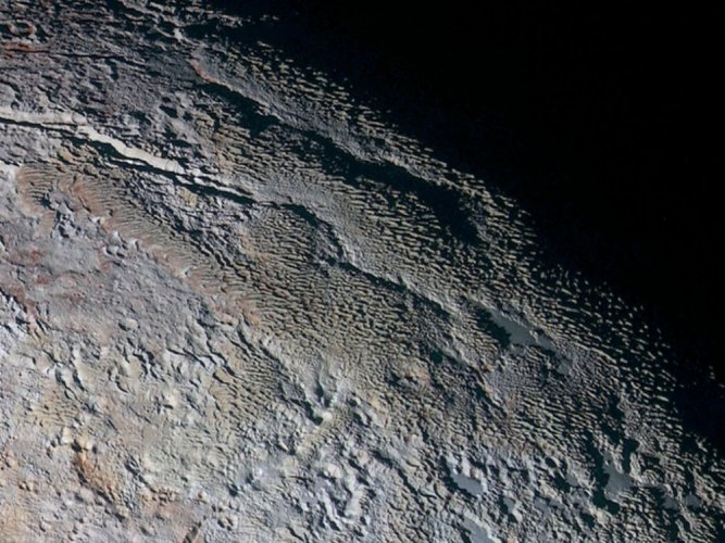 Earth-like snow, ice features found on Pluto