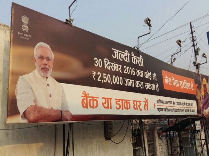 Get PM's photographs removed from govt posters: Cong to EC